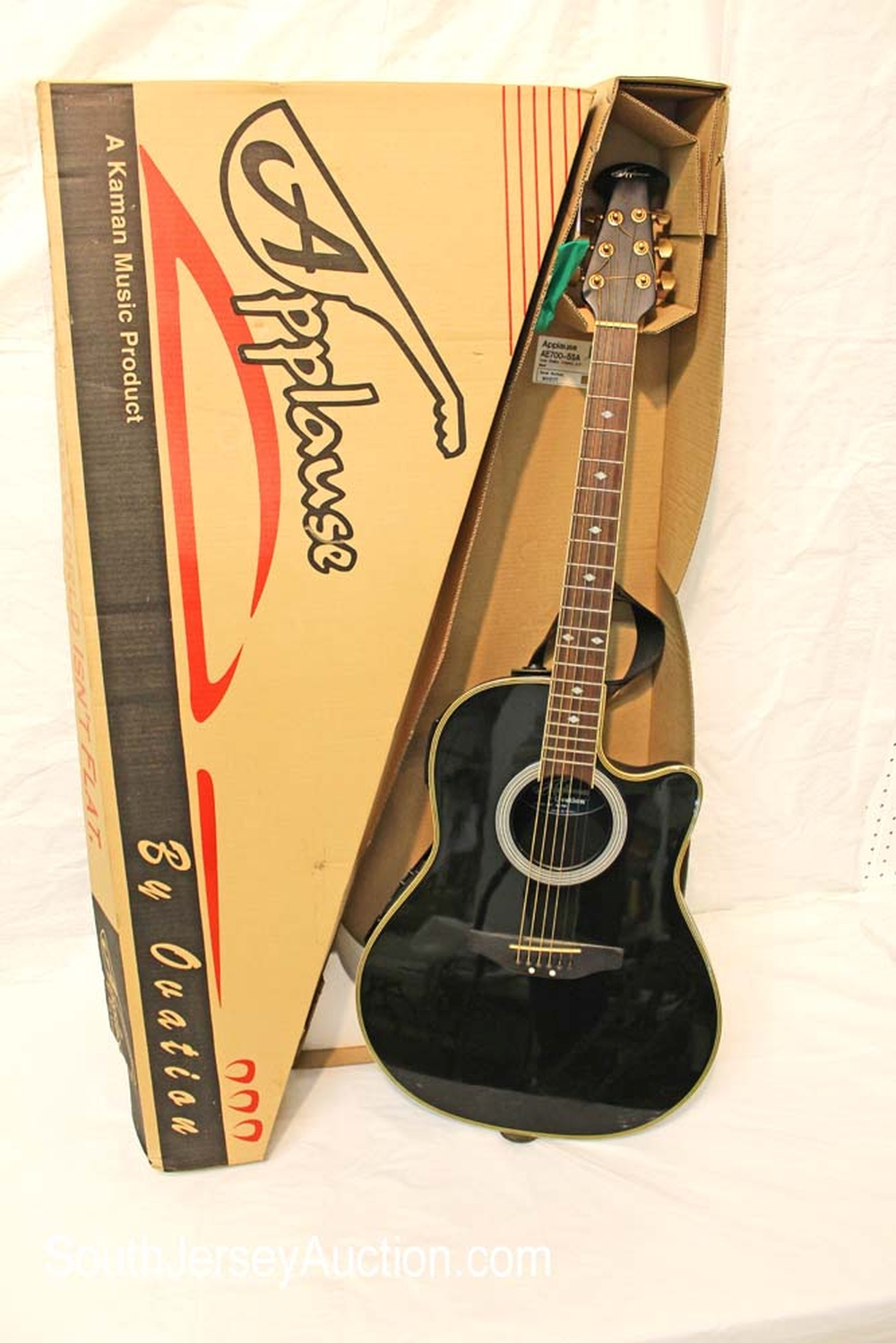 Late 90's Applause by Ovation Super Shallow, Cutaway, A/E in the black, round back guitar, made in Korea, has addition plate to reduce sliding, model number AE700-5SA acoustic guitar, a Kaman Music Product, original, good condition, believe s/n 9005177 with original box, some paperwork and strap