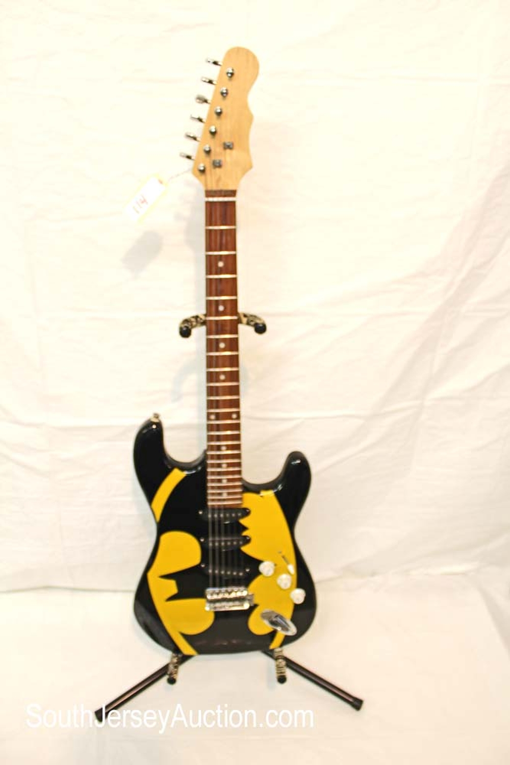 Batman guitar, year unknown, maker unknown, serial number unknown no strap