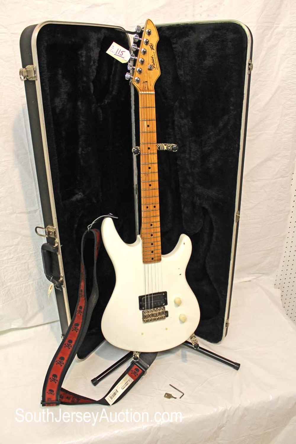 1979 Peavey Patriot guitar, made in the US, with skull strap, s/n 02783930, considered a player with hard shell Peavey case, case key and wrench