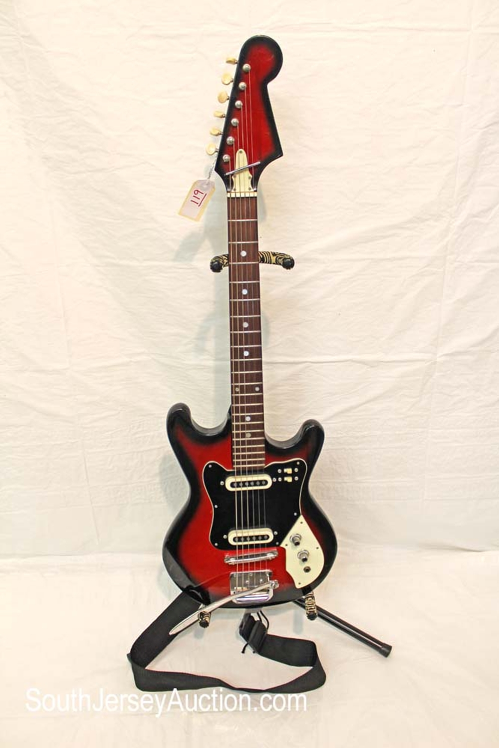 1960 Teisco, VERY RARE guitar, made in Japan, with whammy bar, all original,  in good shape with original pick ups, with light scratches