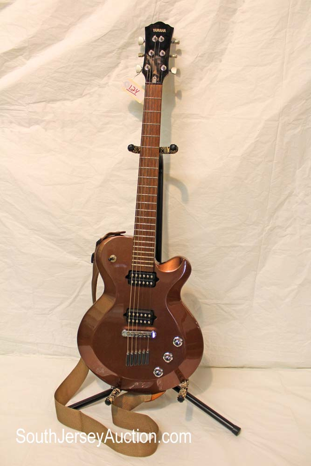 Yamaha guitar model AES820, year unknown, in the bronze finish, RARE spergel tuners, s/n #Q1x029145, model AES820, bolt on neck with strap and original pick ups, very good condition