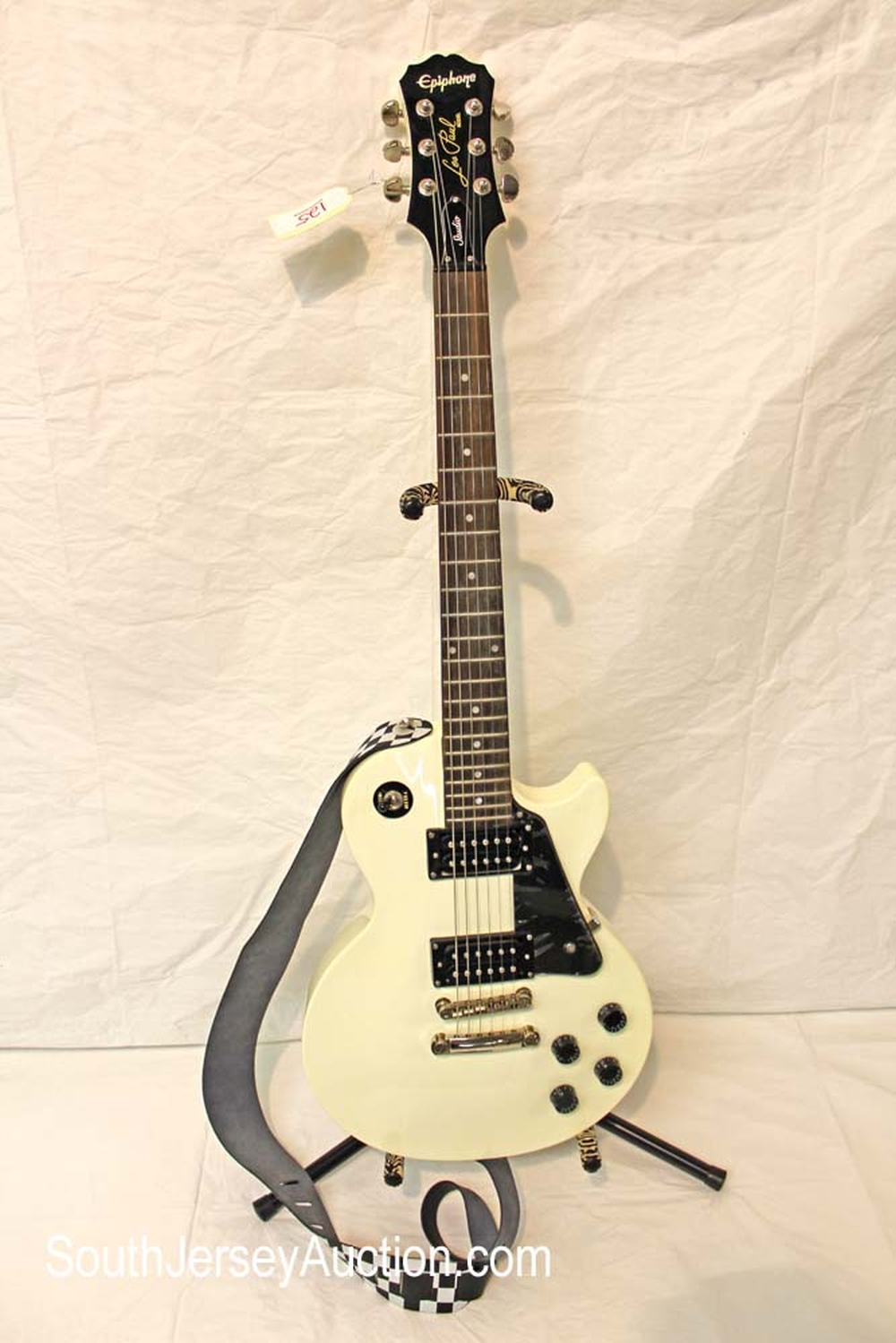 2011 Les Paul Epiphone Limited Edition Studio Custom Shop guitar, in the white color, still has plastic on pick guard, s/n #311496785, 2nd grover tuners and strap, excellent shape