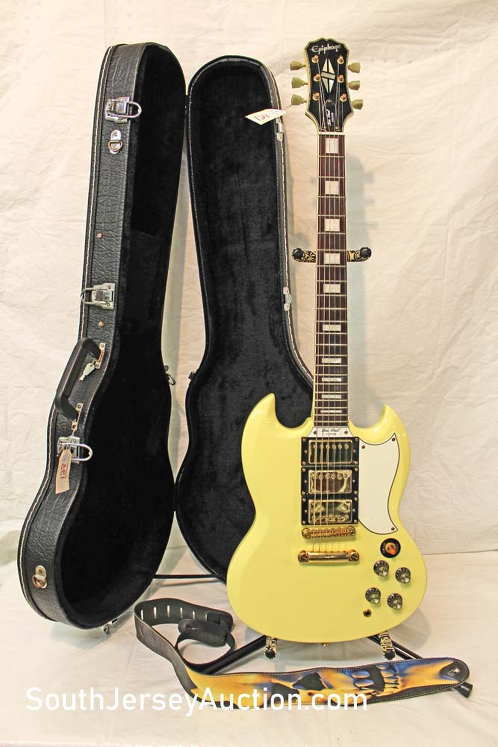 1999 Epiphone SG, Very RARE Les Paul Custom with triple pickups, gold hardware, set neck, with original hard shell case s/n # 199040165, creamy yellow no belt rash no pick up scratches, match strap, made in Korea, with strap and hard shell case, excellent condition