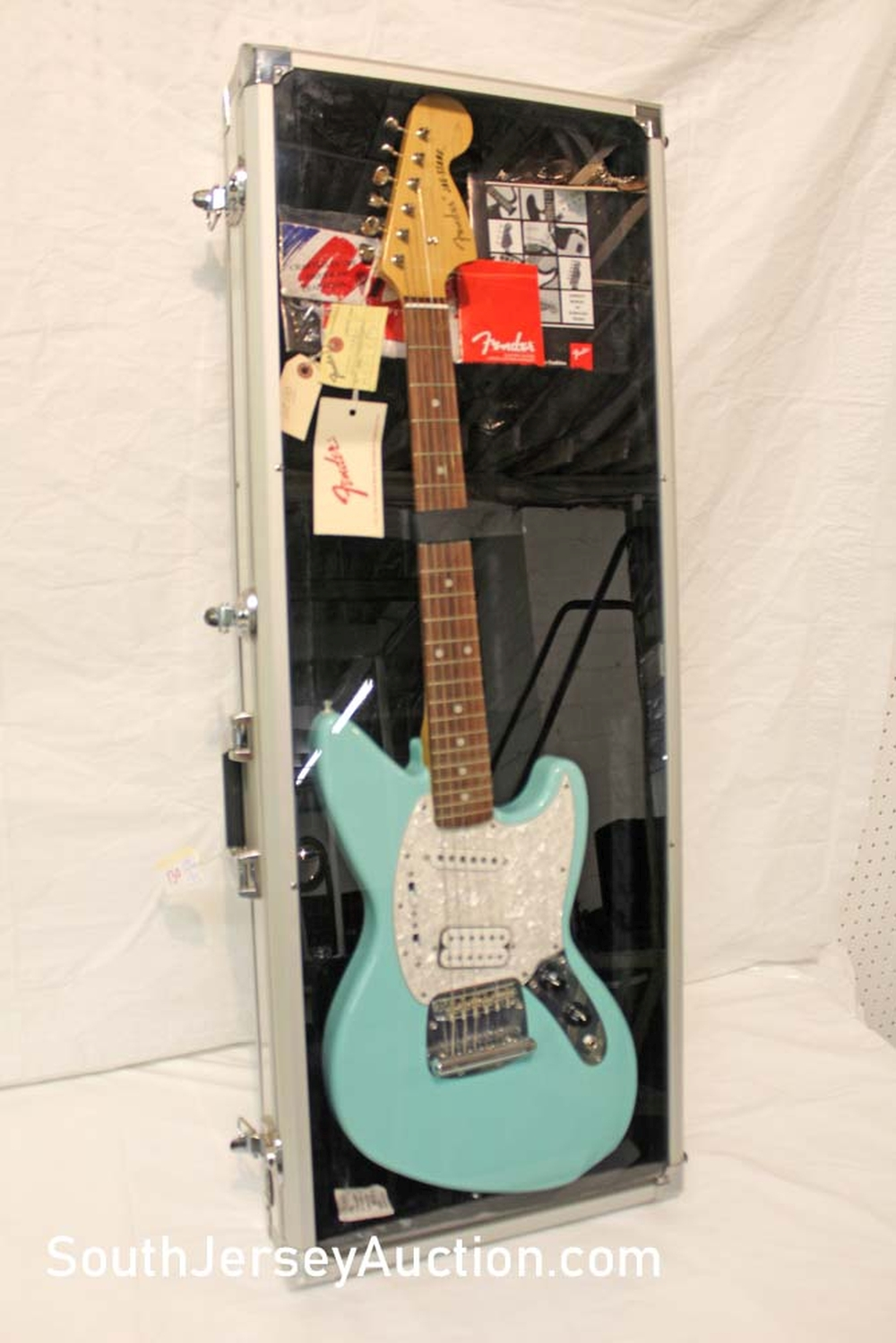 1997? NEW Fender Jag Stang Kurt Cobain Sonic Blue Color guitar, Never Been Played, All the Case Candy, in Aluminum Display carrying case, all original, with paperwork, crafted  in Japan, s/n A005079 excellent condition