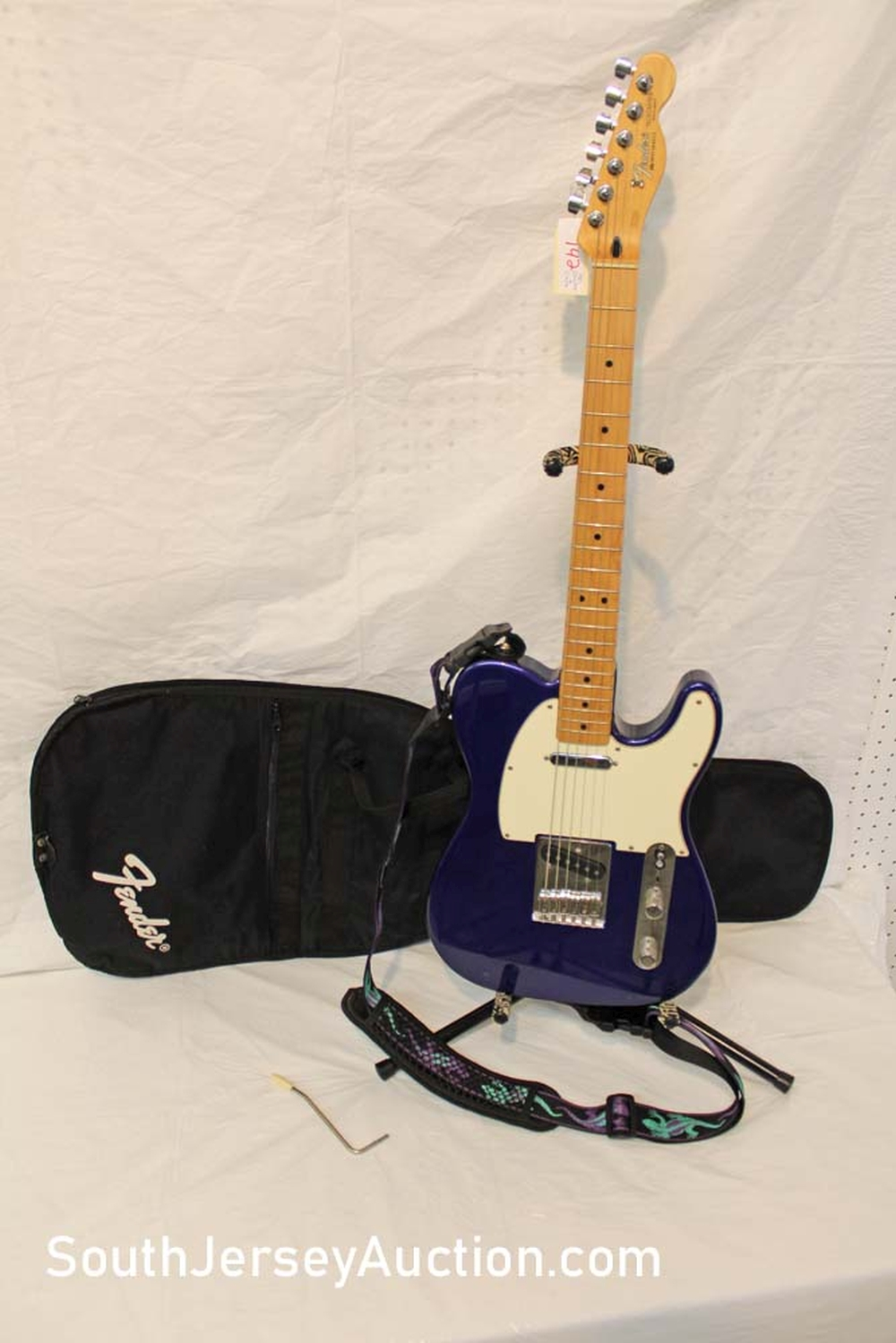 1998 Telecaster guitar in the odd color of purple/blue, made in Mexico, with strap, single and lipstick pickups, s/n MN9384022, with soft Fender case excellent condition