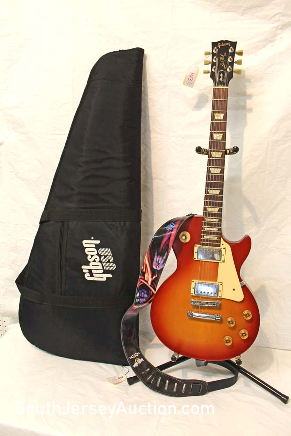 2007 Gibson Les Paul Studio guitar in the cherry burst color, set neck, with strap an Gibson USA soft gig bag, some buckle rash on back, finish on front is excellent