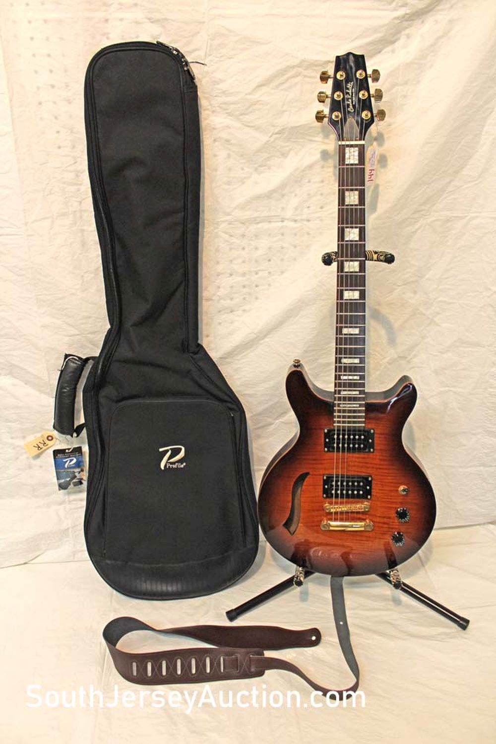Carlo Robelli, year unknown, single F hole, tiger stripe maple in flaming finish,  mother of pearl inlay, with Profile soft gig bag, good condition