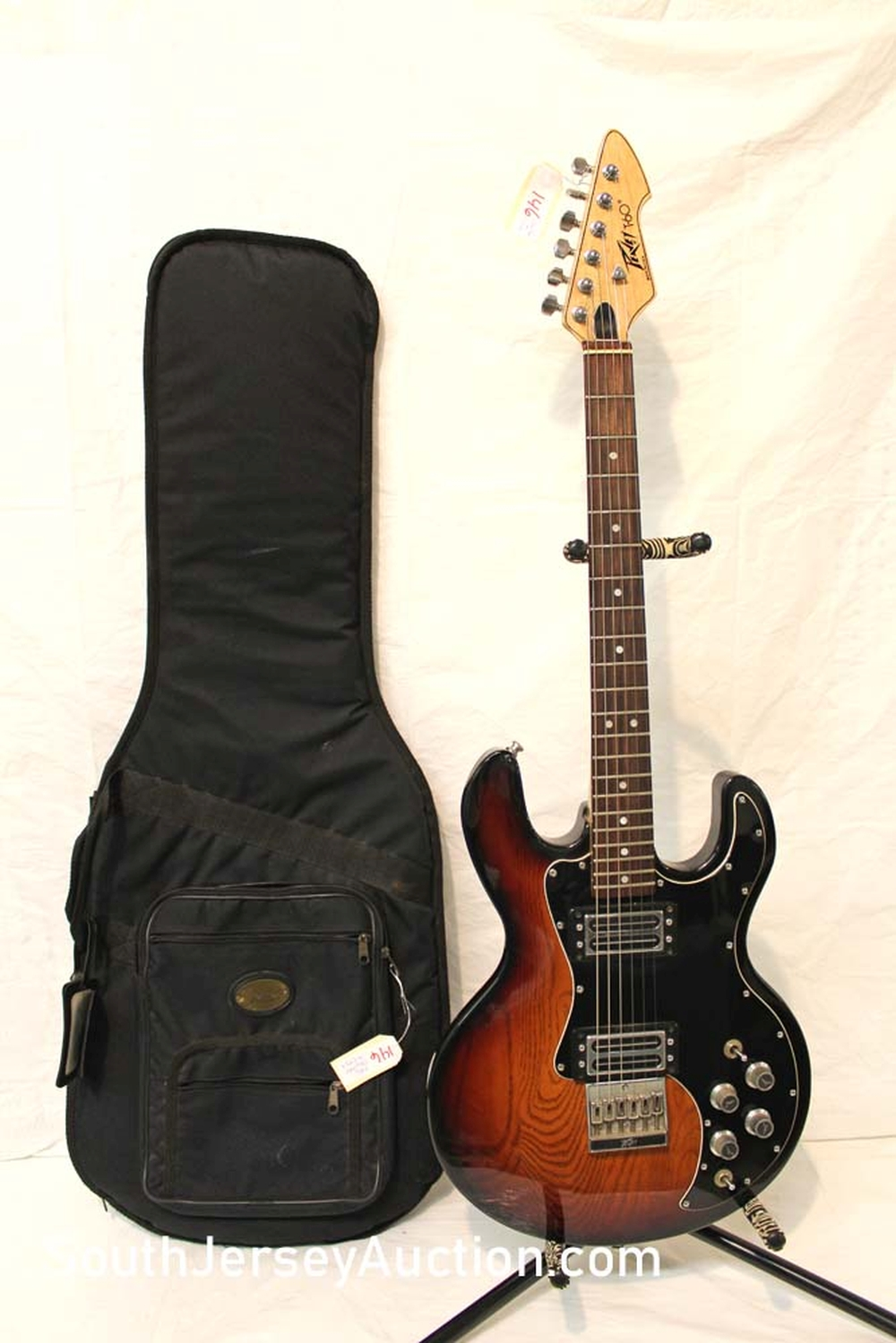 1981 PEVEY model T60 guitar, tobacco sunburst color, s/n 01403778, with Fender multi pocket gig soft bag, with strap, all original, very good condition