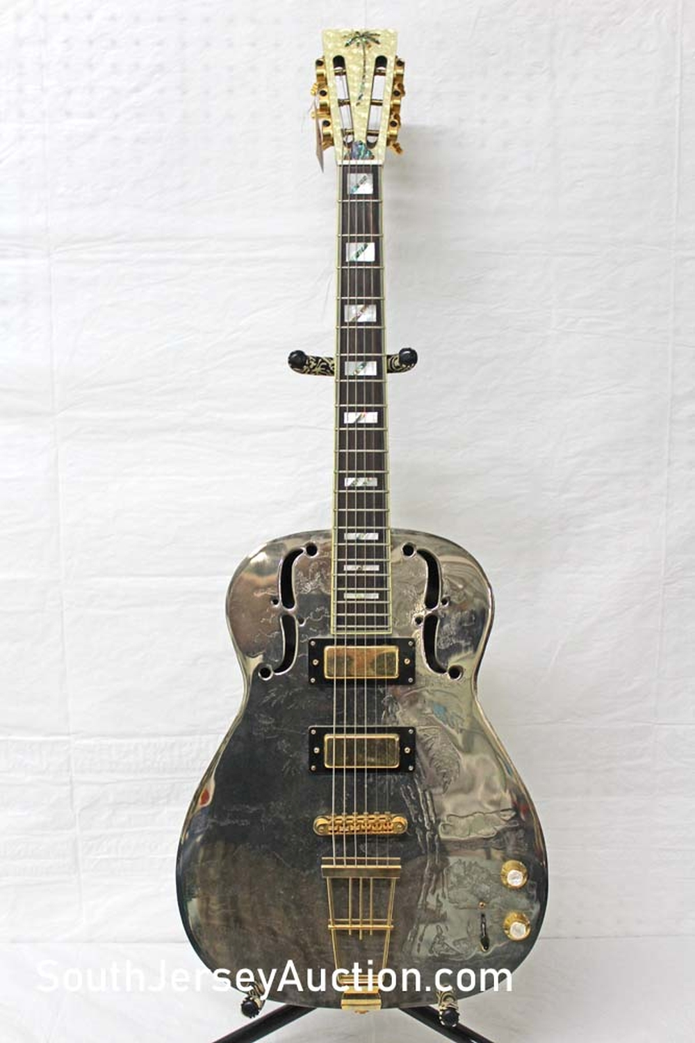 Galveston, year unknown,  double F hole, rosewood fretboard, gold hardware, chrome plated bell brass engraved, mother of pearl head with inlaid two tone palm tree, very good condition
