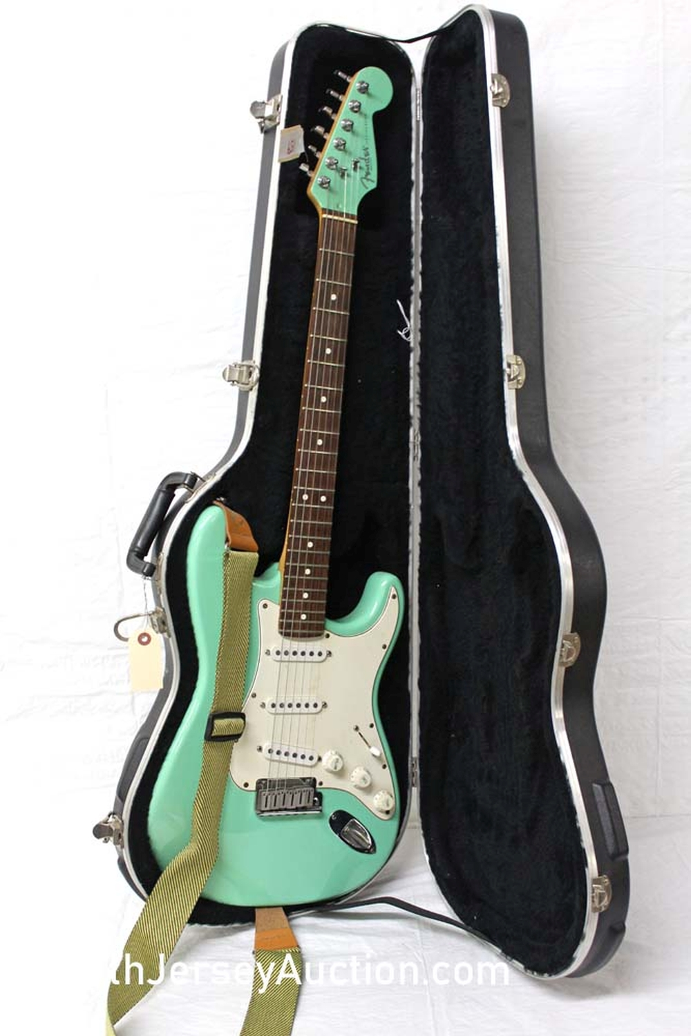 1995 Fender Stratocaster, made in the US, Sea-foam Green (color only made for a couple of months), rosewood neck, with painted head stock, single single single pickup,  s/n n553625, rosewood fretboard,  with hard shell case, excellent condition