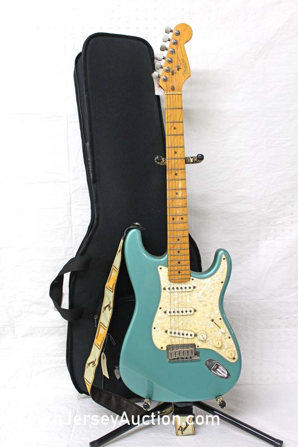 1997 Fender Stratocaster, made in the US, Pearloid pick guard, Rare Teal Green color, single single single pickups, s/n n7223646, maple fretboard, tail stock has been blocked, with soft gig bag, excellent condition