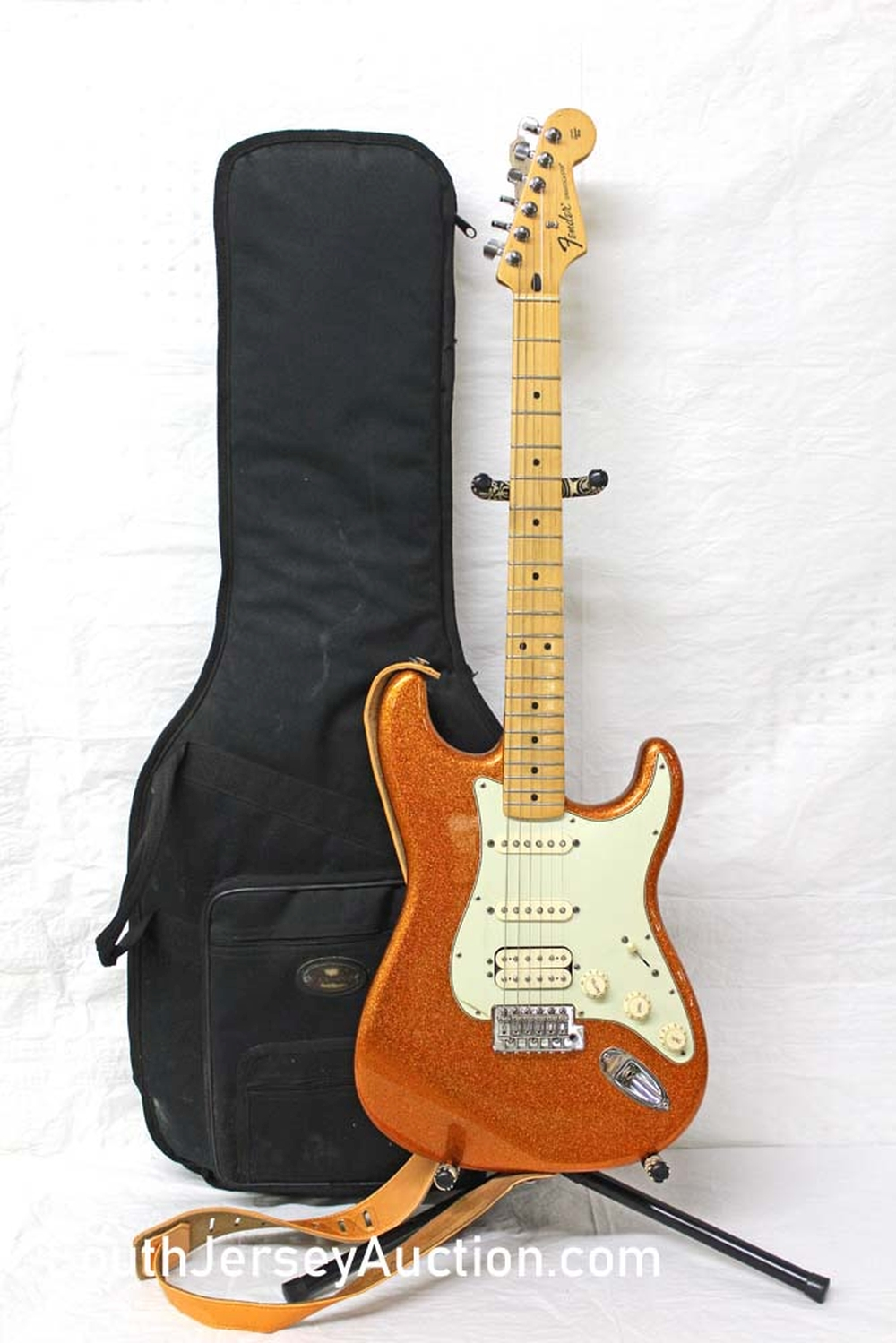 2010 Fender Special Run, Made in Mexico, Stratocastar, Limited Edition in the gold metallic s/n mx10151684, double single single pickups, maple neck, plastic still on pick guard, with soft gig bag, perfect - excellent condition