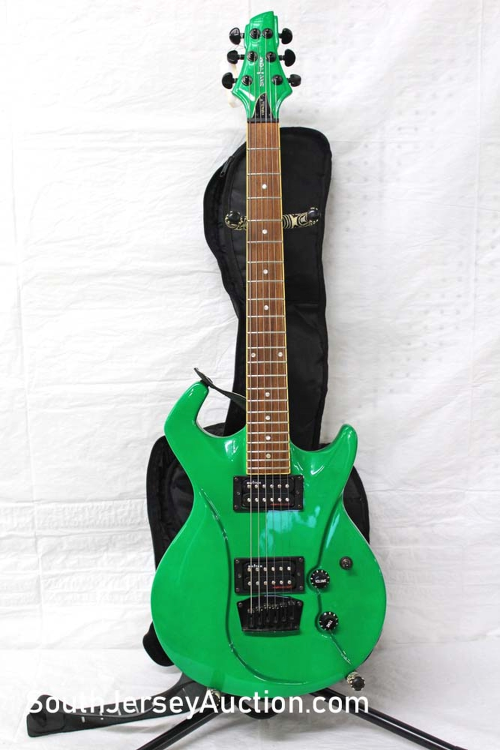 Switch, Vibracell, year unknown, vacuum formed guitar, made in China,  screaming green color with painted head stock, maple fretboard,  s/n 0773087, very good condition