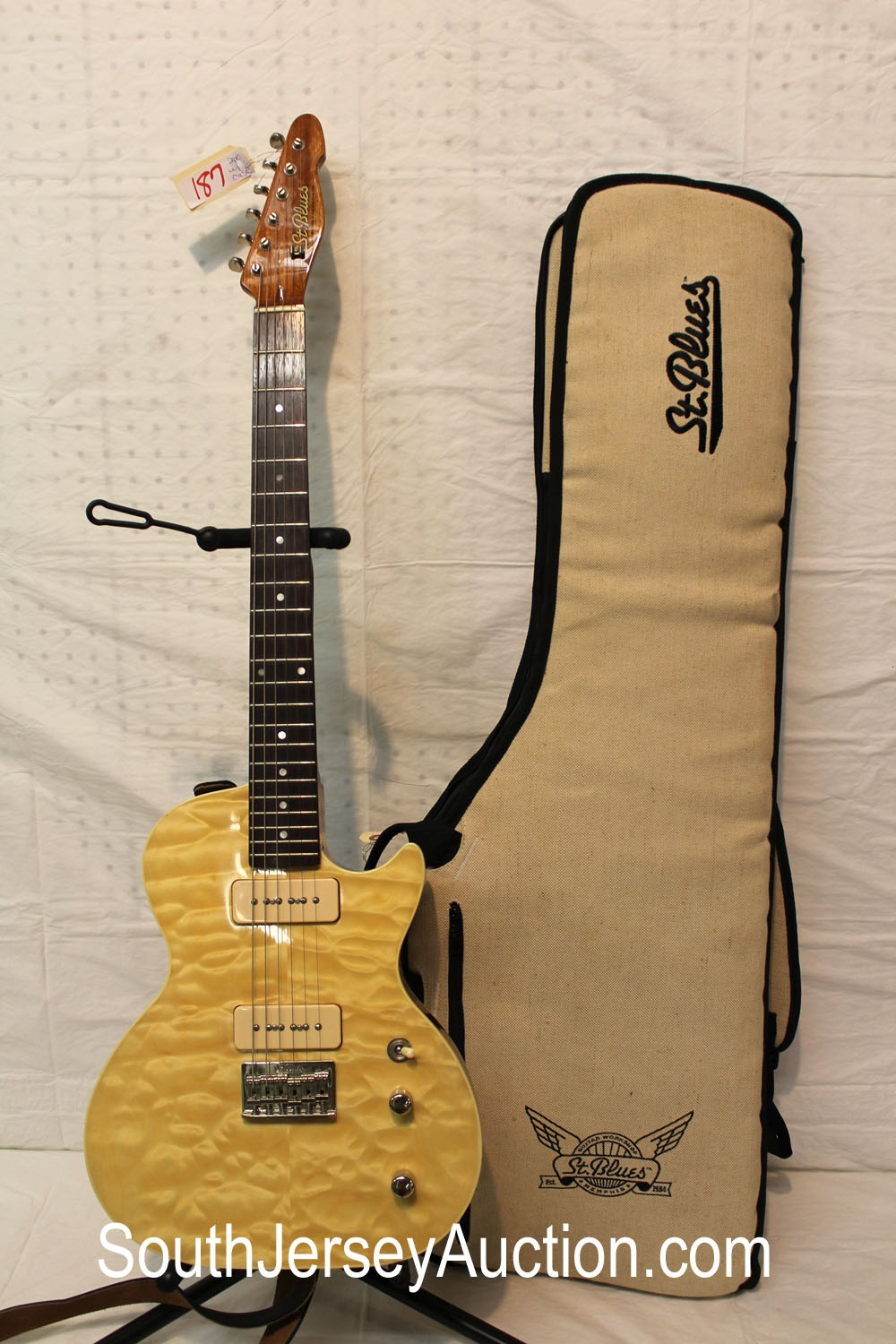 Saint Blues in Memphis Tennessee, year unknown, maple light tiger eye finish, P-90 pickups, made in Korea, s/n S090410620, very good condition with match soft gig bag
