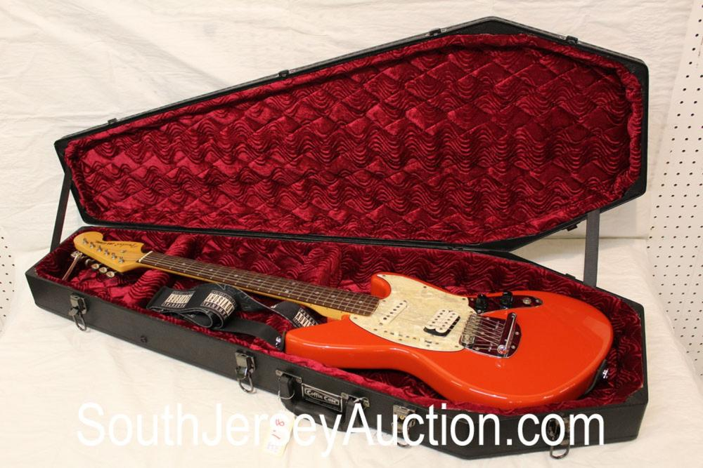 1997 Fender Jag Stang, designed by Kurt Cobain SP style, made in Japan, in the fiesta red, s/n U026837, double single pickups, with black fitted coffin case, with strap, in good condition