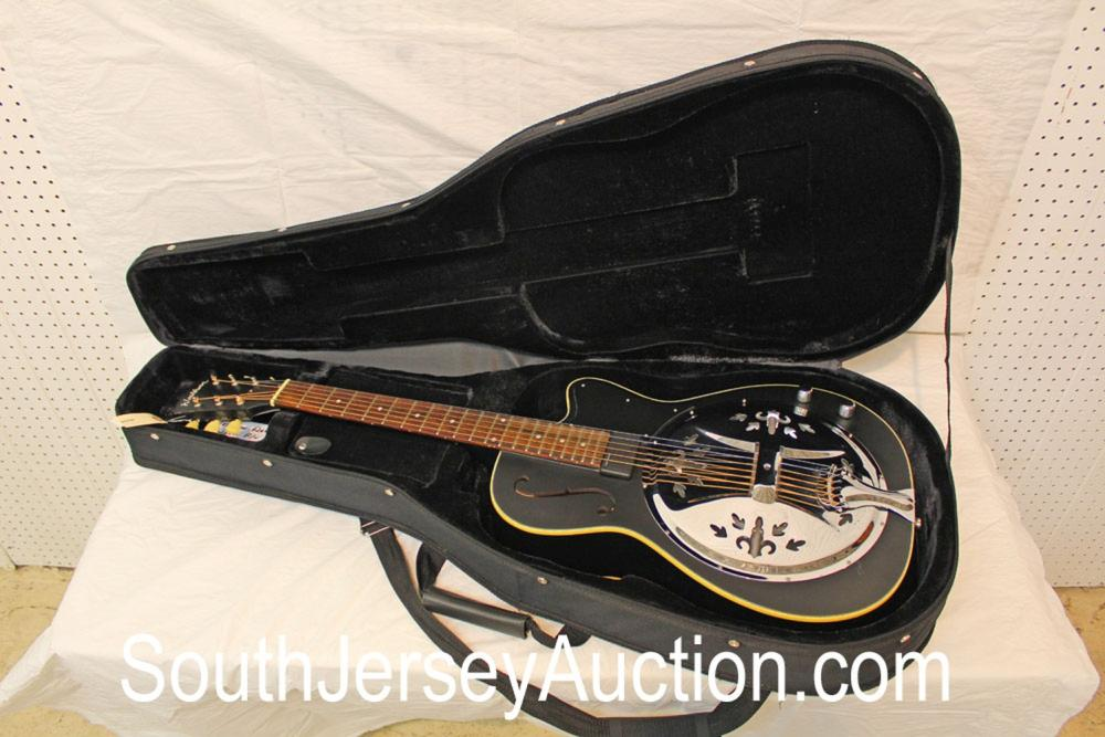 Washburn Dobro, year unknown, in the black, with pickup, single f hole, hard soft side gig bag, some buckle wear, good condition
