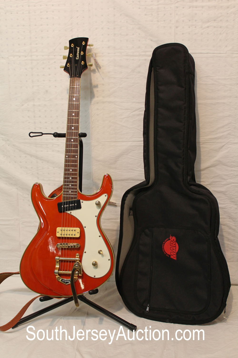 Eastwood in the tangerine top finish, gold hardware, Bigsby whammy bar, p-90 and humburcker pickups, with strap, with hard side bag in good condition with some buckle rash