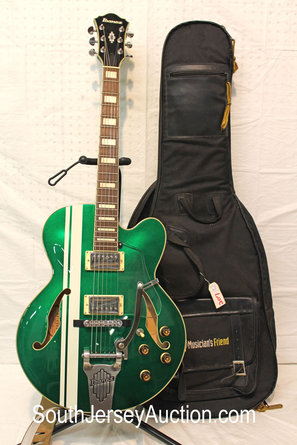 Ibanez 2010 Roadster, full hollow body, bigsby style whammy bar, very good condition, metallic green with white stripe, s/n N427, double f holes, with soft gig bag