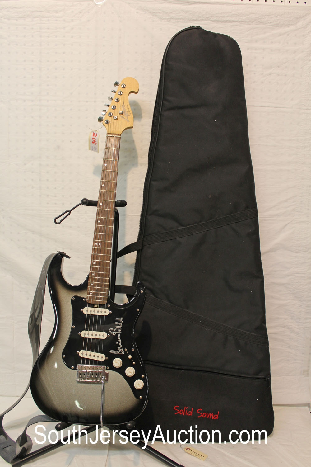 Lyon  by Washburn Stratocaster style, autographed by Brian Bell from Weezer,  black and silver burst fender style,  s/n 5376 of 6000