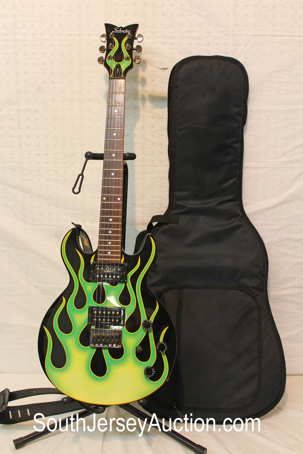 Schecter Diamond Series Flame with green flames, year unknown, made in Korea, s/n 0211427, good shape, with soft gig bag, with strap
