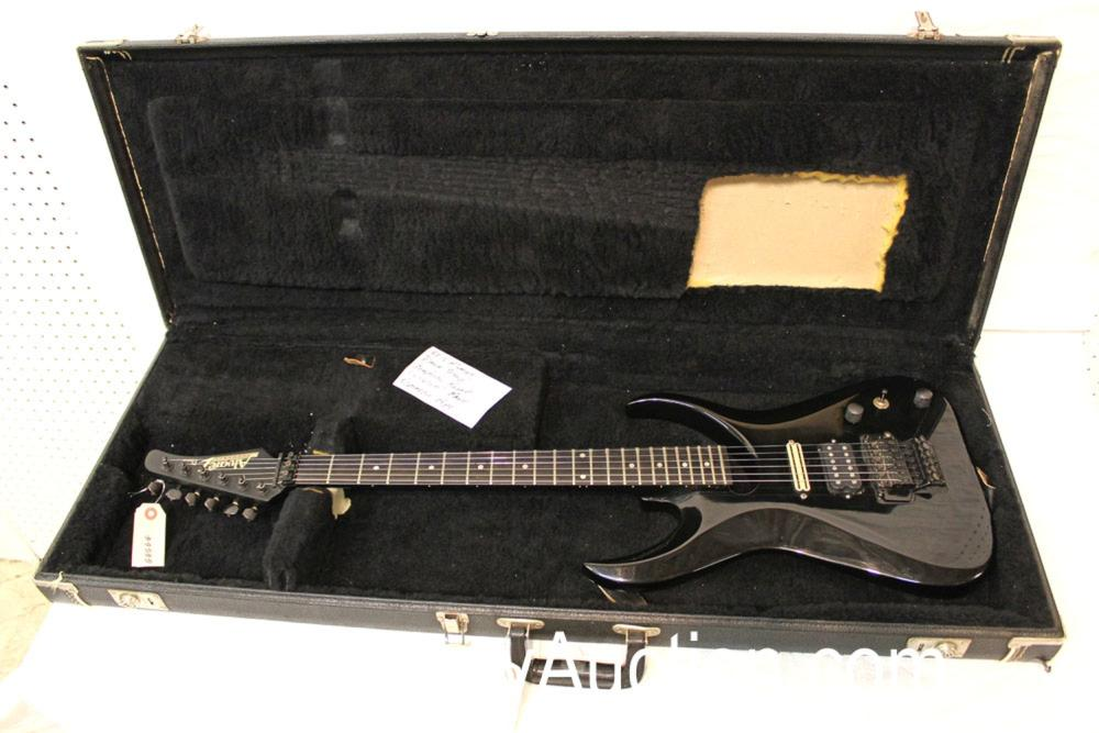 1990's Dana Scoop, Alvarez, graphite neck, Very Rare, Dimarzio pickups and also  with original pickups that came with it are in the hard shell case, s/n 055761, with modulus graphite patented neck, good condition