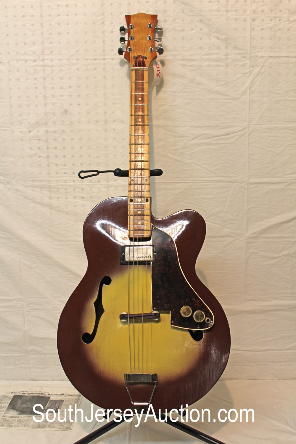 Jerry Sceusa, known for being guitar beautiful neck maker who decided to build 'one and only one' guitar - ugly guitar, with news article from Prescott Valley Tribune