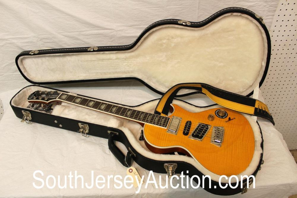 Epiphone 2011, Night Hawk Custom Re-issue, in the butter scotch maple, with case candy, in like new condition with hard shell case