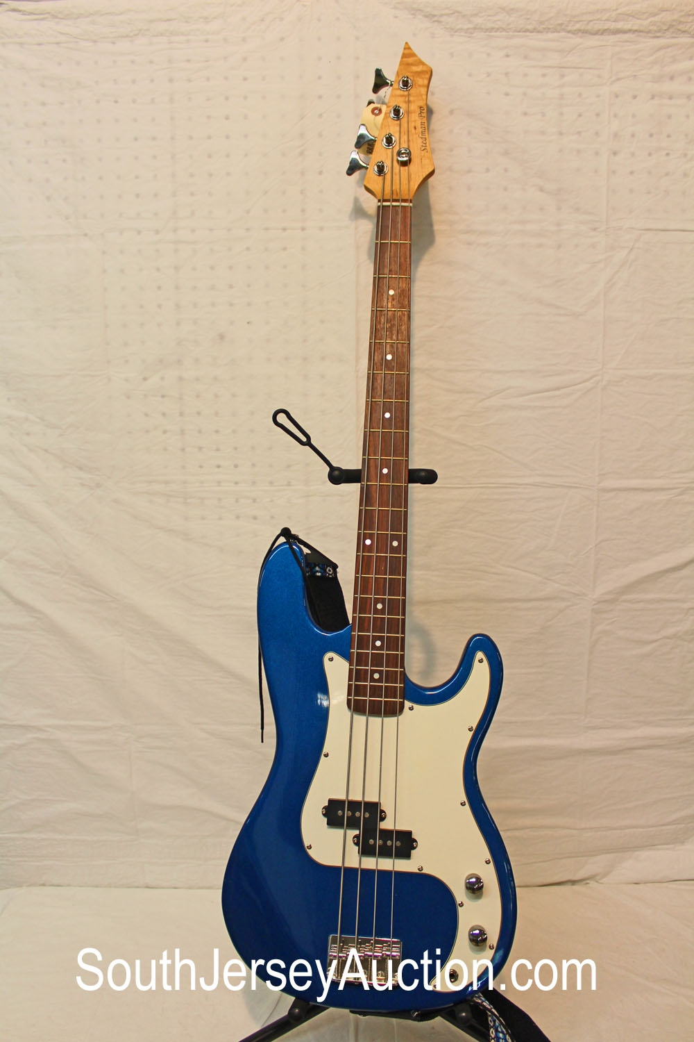Stedman Pro Base Guitar, in metallic blue, good shape, year unknown, with strap