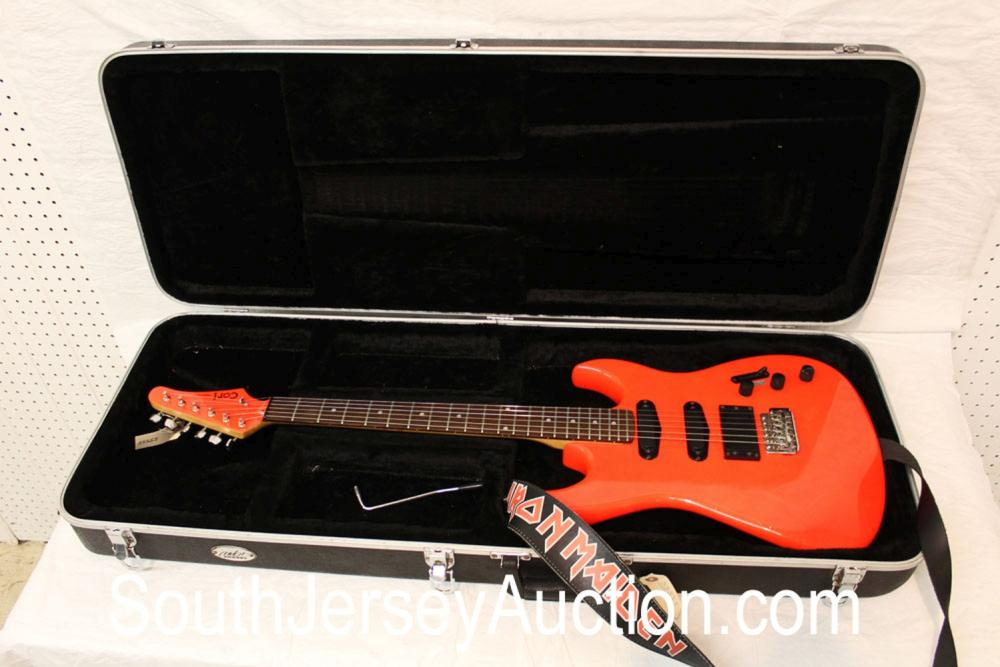 Cort Panther in the fluorescent orange,  with strap, active pick ups, it's considered a player, with hard shell case