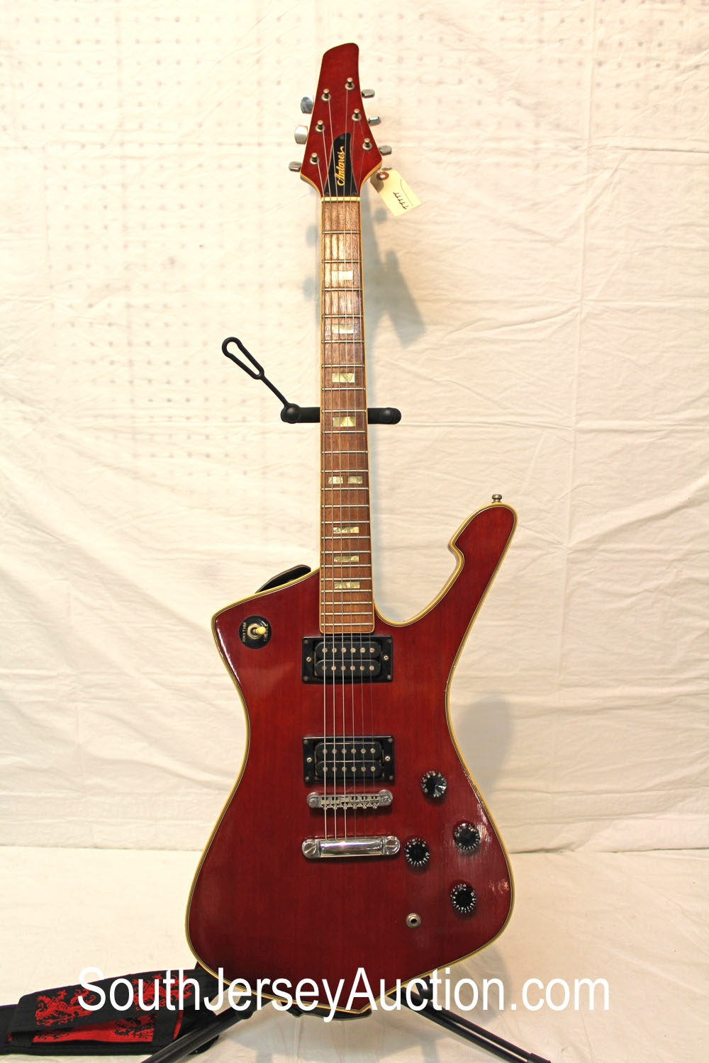 1980 Antares, Iceman Copy, lawsuit era, dimarzio pickups, RARE, in the wine color, mahogany fretwork, painted head stock, with strap, good condition for age