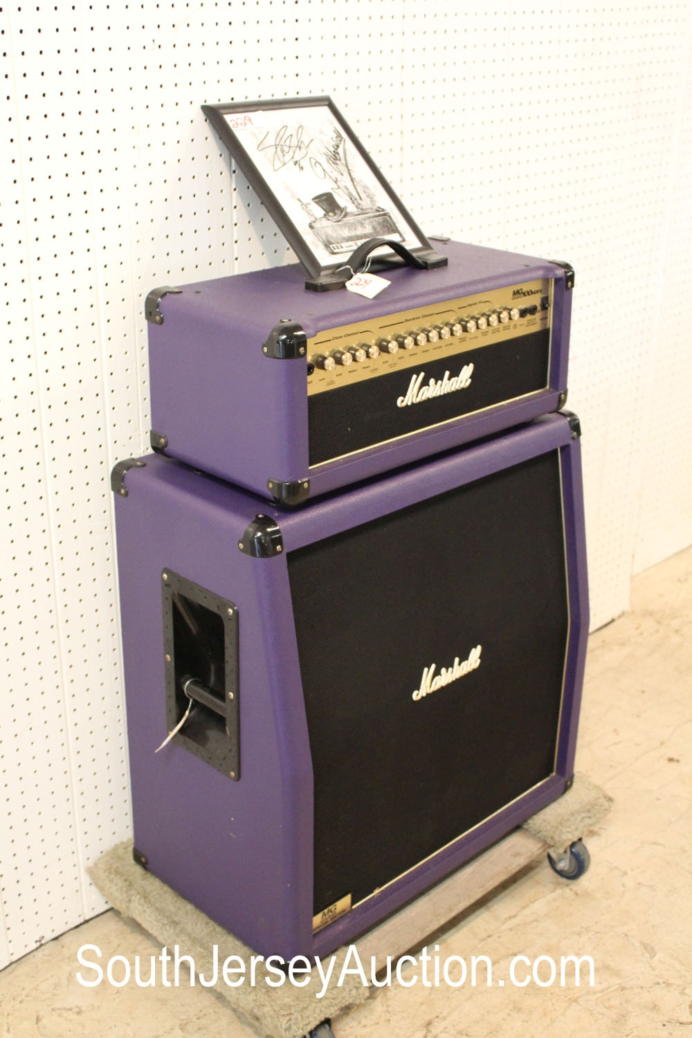 Marshall Half Stack Transistor Head MG100 HDFX in the purple tolex, with bonus autographed reproduction memorabilia of Jim Marshall and Slash dated 1996 (2 piece lot)