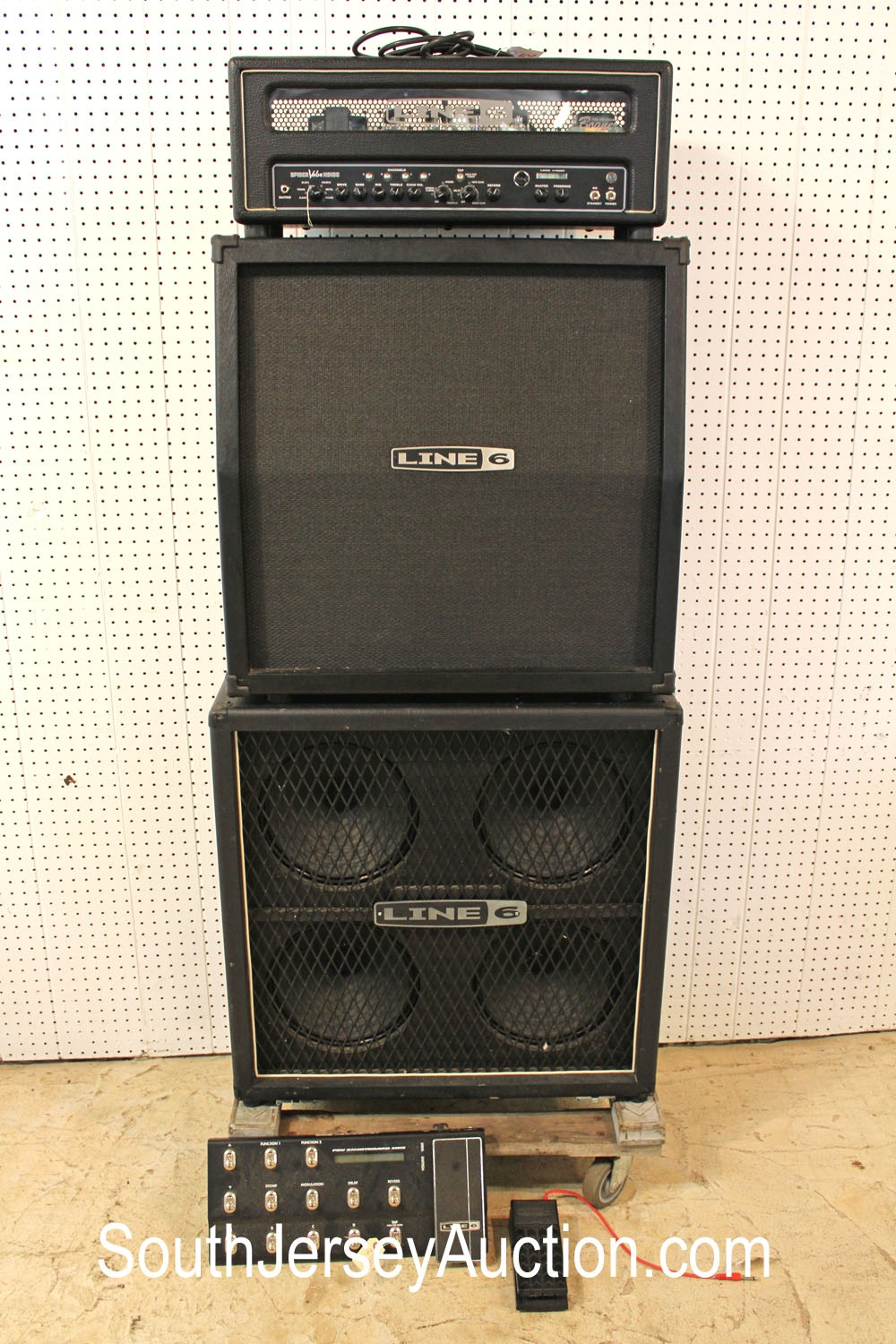 Line 6  4x12 Cabinet on Tour Megadeth Armageddon Bogner Line 6 Tube with a Line 6 bottom Cabinet signed on top by Dave Mustaine from Megadeth, on stage in 2012 on the Armageddon (sp) tour no PSDNA , working condition with volume pedal and effects pedal (amp and 2 speakers, full stack for a 5 piece lot)