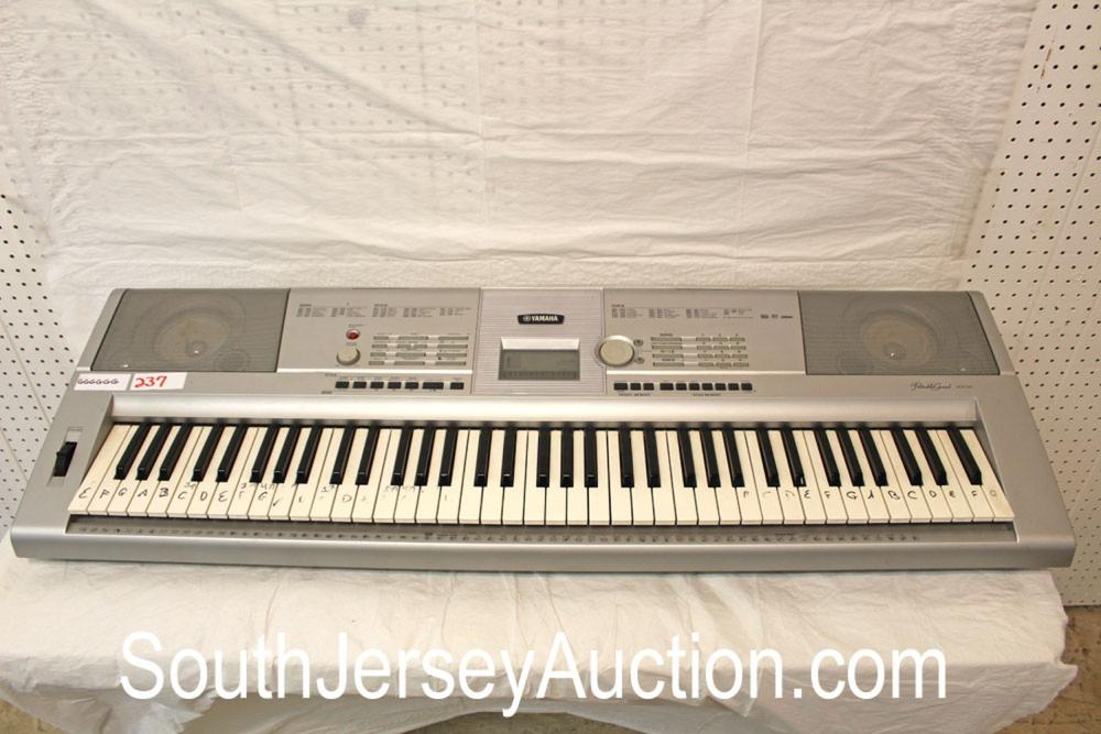 Yamaha Portable Grand DGX-205 Keyboard in fair condition (keys have been lettered)