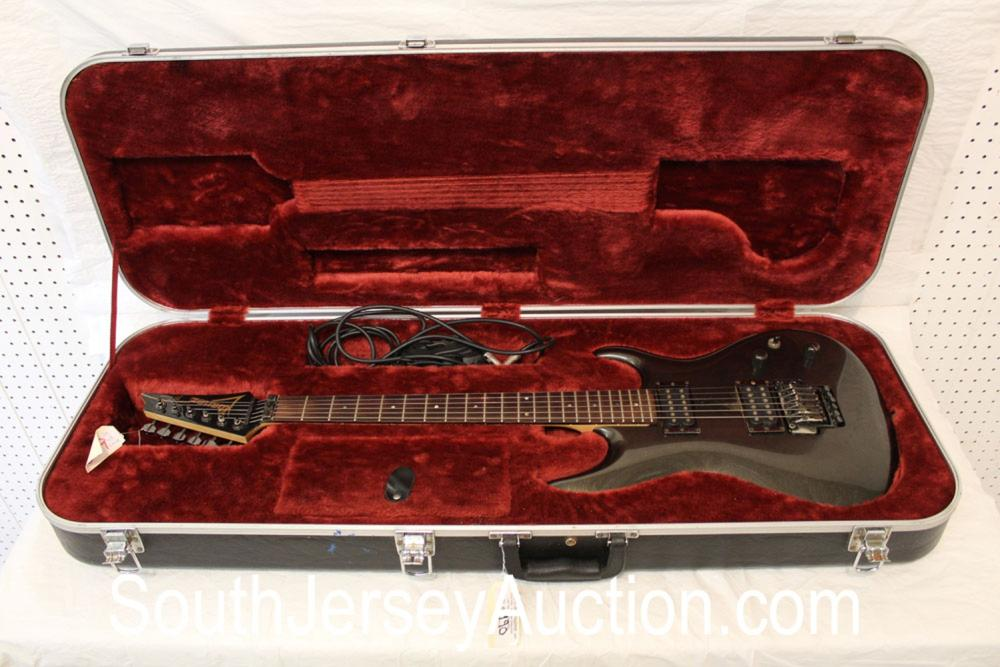 Ibanez JS Series electric guitar in good condition with original hard shell fitted case, cored, strap, whammy bar and tools, s/n 019479