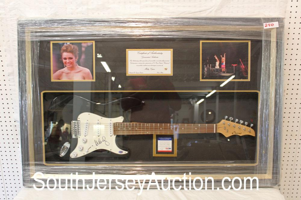 Autograph Crescent guitar by Miley Cyrus in frame with PSA and with slight crack in guitar case