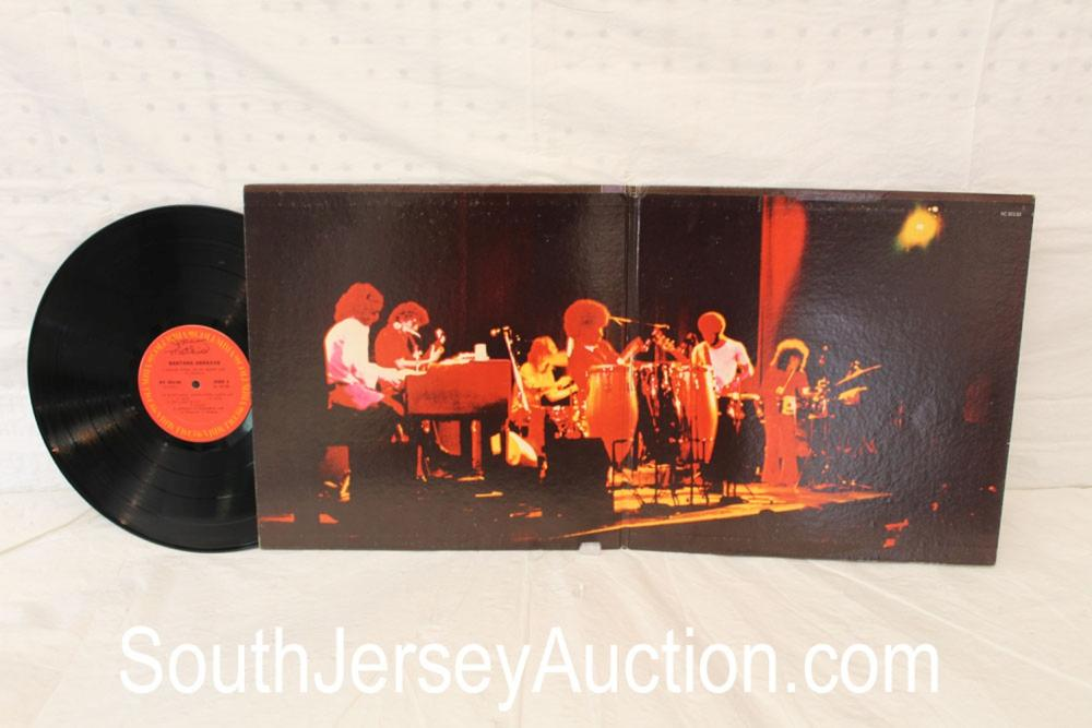 Vintage Santana Abraxas album with original sleeve in display frame in good condition