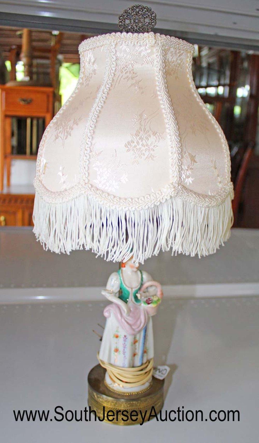 Vintage porcelain figural lamp with fringe shade