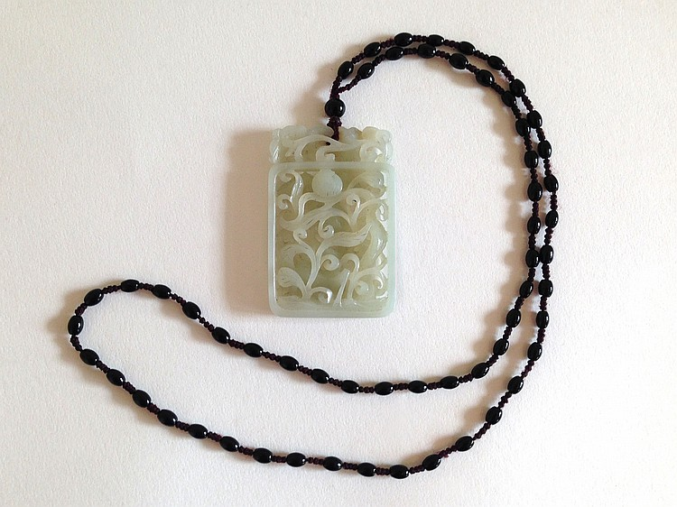 A White Jade Pendant with Beaded Necklace 19th Century
