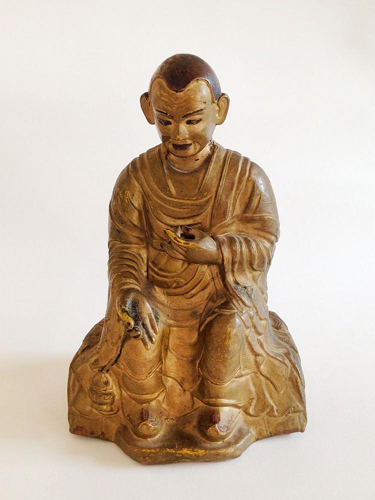 A Gilt-Bronze Figure of a Lama 14th Century