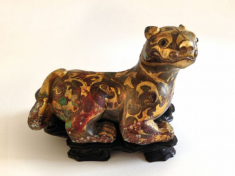 An Inlaid Silver and Gold Bronze Figure of a Tiger Warring States
