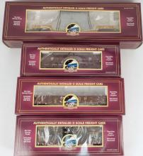 Four MTH freight cars in original boxes