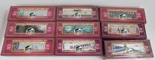 Nine MTH Freight cars in original boxes