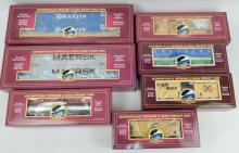 Seven MTH freight cars in original boxes