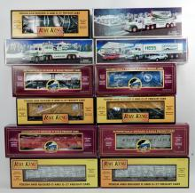 Nine MTH and Rail King freight cars and three Hess trucks