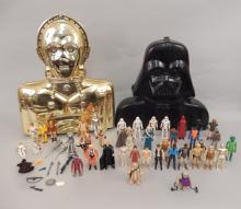 Collection of Star Wars action figures in cases