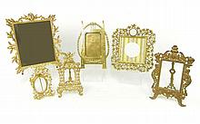 Six ornate brass picture frames