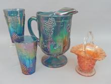 Carnival glass pitcher and two cups, handled basket
