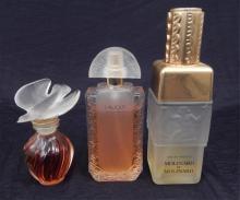 Three Lalique crystal perfume bottles