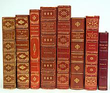 Eight 3/4 gilt leather bound books, 20th C.