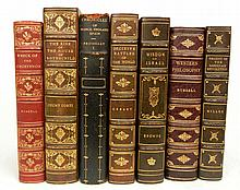 Seven 3/4 gilt leather bound books
